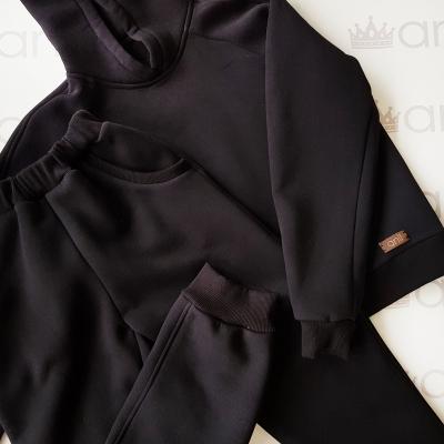 Объемные брюки с начесом черного цвета