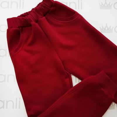 Объемные брюки с начесом бордово-винного цвета
