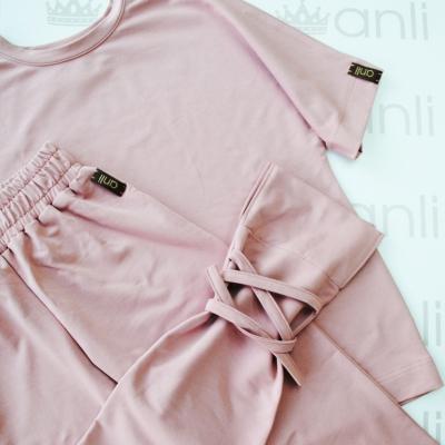 Удлиненная футболка оверсайз кроя пудрового цвета